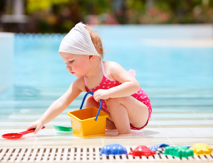 toddler playing by pool